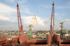 Two port cranes with cargo train. Port of St.Petersburg Royalty Free Stock Photo