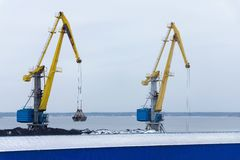 Two port cranes in a coal warehouse Stock Images