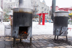 Two portable potbelly stoves for cooking outdoors Stock Image