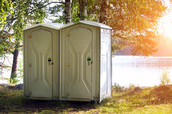 Two portable toilet. Or loo in plastic at a park stock image