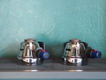 Two of portafilter coffee handle on stainless shelf.  Royalty Free Stock Photo