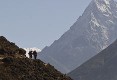 Two porters. Sagarmatha National Park, Himalayas, Nepal Royalty Free Stock Images