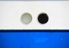 Two portholes on blue and white coaster background Royalty Free Stock Photo