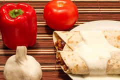 Two portion of burrito. Portion of burrito with garlic souce on a plate stock image