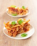 Two portions of lasagne Stock Images