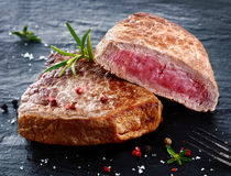 Two portions of lean trimmed grilled beef steak stock image