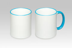 Two positions of a white mug. On a gray background royalty free stock photo