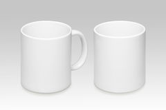 Two positions of a white mug. On a gray background stock photo