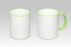 Two positions of a white mug stock photography