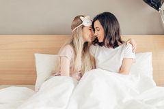 Two positive attactive girls are gossiping with each other. Close up photo. sensece feeling, emotion , love concept stock images