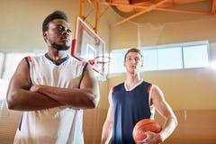 Confident athletes on basketball court royalty free stock photo