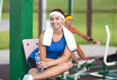 Two positive caucasian female athlete in good fit having training outdoors Royalty Free Stock Photos