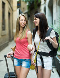Two positive girls with luggage Stock Photos