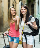Two positive girls with luggage Stock Images