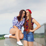 Two positive hipster girlfriends. Stock Images