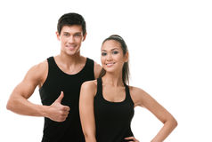 Two positive sportive people in black sportswear Royalty Free Stock Image