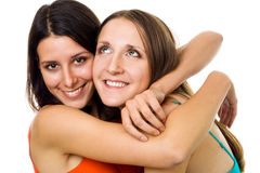 Two positive young woman smile hug Stock Photo