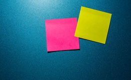 Two post it paper on blue background stock images