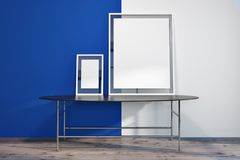 Two posters in a blue and white room. Modern living room interior with bright blue and white walls, a wooden floor, and two vertical mock up poster frames Stock Photos
