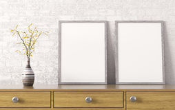 Two posters on chest of drawers 3d rendering. Two posters and vase on wooden chest of drawers over white brick wall interior background 3d rendering Royalty Free Stock Photography