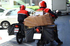 Two Postman. Is driving his motorbike stock photo