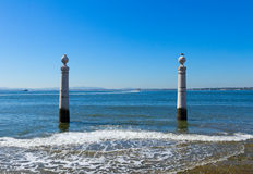 Two posts at the embankment of Lisbon Royalty Free Stock Photo