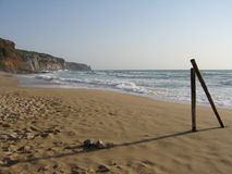 Two posts on an empty beach. Two posts on an empty sandy beach by the ocean in San Nicolo, Sardinia, Italy stock photo
