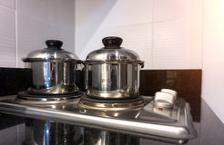 Two pot boiling water in kitchen. A two pot boiling water in kitchen Stock Photography