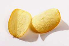 Two potato chips royalty free stock photos