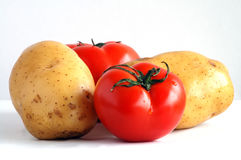 Two potatoes and two tomatoes (1) royalty free stock photo
