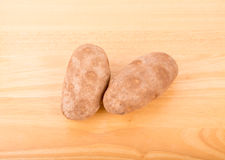 Two Potatoes on a Wood Table Royalty Free Stock Photo