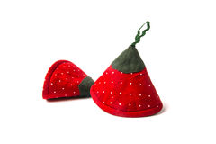 Two potholders strawberries for hot dishes on a white background Stock Photos