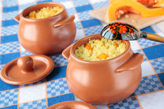 Two pots of millet porridge with pumpkin Royalty Free Stock Photography