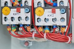 Two power contactor with adjustable and connected to it by wires. Stock Images