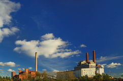 Two power plants. With blue skies Royalty Free Stock Images