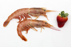 Two prawns and a strawberry Royalty Free Stock Photos