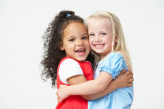 Two Pre School Girls Hugging One Another Royalty Free Stock Photos