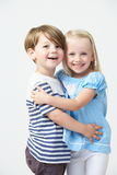 Two Pre School Pupils Hugging One Another Stock Photo