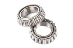 Two precision metal bearings on a white background.  Stock Images