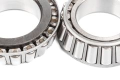 Two precision metal bearings on a white background. Close up.  stock images