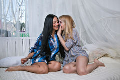 Two preety girls share secrets and having fun Royalty Free Stock Photography