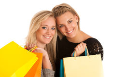 Two preety girls with shopping bags Royalty Free Stock Photo