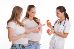 Two pregnant women and doctor. Stock Photo