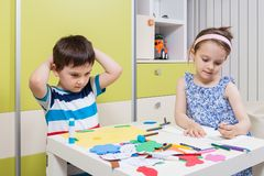 Two preschool child create shapes and designs Stock Photography