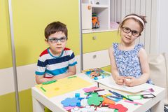 Two preschool child working for homework from kindergarten Royalty Free Stock Image
