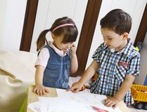 Two preschool children learn the numbers Stock Photos