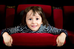 Two preschool children, twin brothers, watching movie in the cin Royalty Free Stock Images