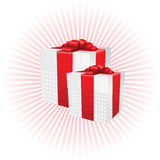Two present boxes on radial background Royalty Free Stock Photos