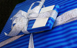 Two presents. Wrapped with blue paper and lace Stock Image