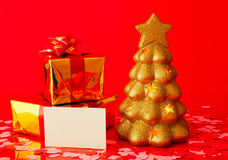 Two presents, blank card and golden evergreen tree Royalty Free Stock Image